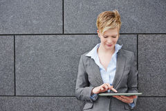 Woman using tablet PC outdoors Royalty Free Stock Images