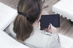 Woman using a tablet pc Stock Photos