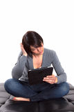 Woman using tablet PC. Smiling young woman using tablet PC Stock Image