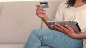 Woman using tablet pc to shop. In slow motion stock footage