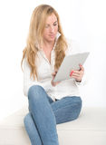 Woman using a tablet Stock Images
