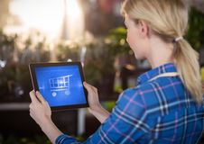 Woman using Tablet with Shopping trolley icon Stock Photography