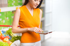 Woman using tablet at store Royalty Free Stock Photo
