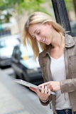 Woman using tablet in the street Stock Image