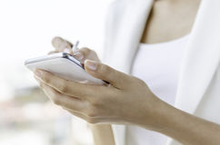 A woman using tablet with stylus pen Stock Photo