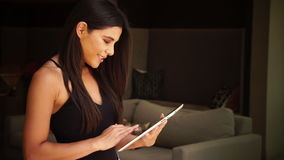 Woman using tablet. Swiping through pages to operate app stock video