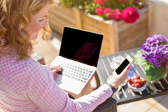Woman using tech gadgets. Outdoors Royalty Free Stock Image