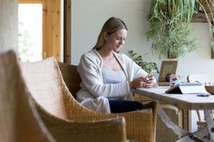 Woman using technology at home Stock Photos