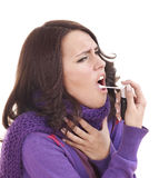 Woman using throat spray. Stock Photo