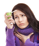 Woman using throat spray. Young woman using throat spray Stock Images