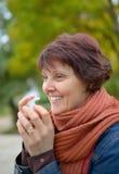 Woman using throat spray Stock Image
