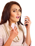 Woman using throat spray. Young woman using throat spray Royalty Free Stock Photos