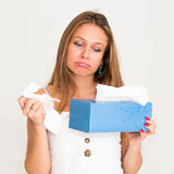 Woman using tissue Royalty Free Stock Image