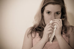 Woman using tissue Stock Image