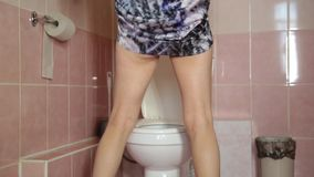 Woman Using a Toilet like a man.  stock footage