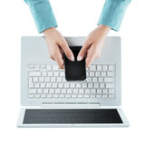 Woman using a touch screen smart phone Stock Photography