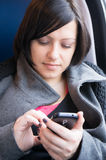 Woman using a smartphone Stock Images