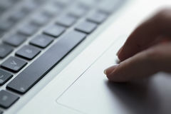 Woman using touchpad on laptop Royalty Free Stock Photography