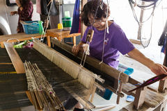 Woman using traditional loom to weave thailand textile Royalty Free Stock Photography