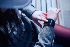 Woman using trendy smart watch Royalty Free Stock Photo