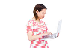 Woman using and typing on laptop Stock Photo