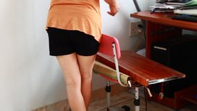Woman using vacuum cleaner. The woman using vacuum cleaner stock video