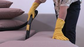 Woman using vacuum cleaner close up. Stock footage video stock footage