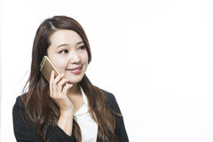 Woman using a variety of mobile devices, Royalty Free Stock Photography