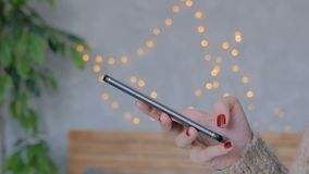 Woman using vertical black smartphone at home. Woman using vertical black slim smartphone at home. Bokeh light background. Entertainment and technology concept stock footage