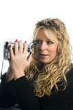 Woman using video camera Stock Photography