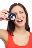 Woman using vintage camera Stock Images