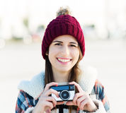 Woman using vintage camera Royalty Free Stock Photo
