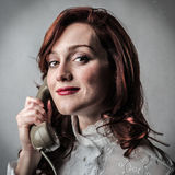 Woman using a vintage phone Stock Photography