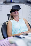 Woman using virtual glasses Royalty Free Stock Images