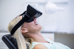 Woman using virtual glasses Stock Photography