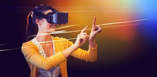 Woman using a virtual reality device stock photos