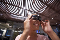 Woman using virtual reality gadget computer glasses Royalty Free Stock Photo