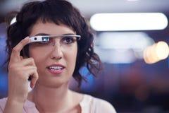 Woman using virtual reality gadget computer glasses Stock Photos