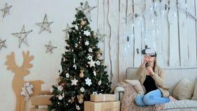 Woman using virtual reality glasses stock video