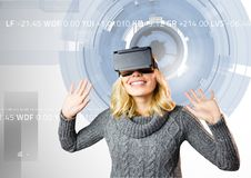 Woman using virtual reality headset against digitally generated background Royalty Free Stock Images