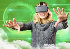 Woman using virtual reality headset against digitally generated background. Smiling woman using virtual reality headset against digitally generated background Stock Images