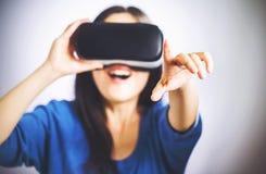 Woman using a virtual reality headset Stock Image