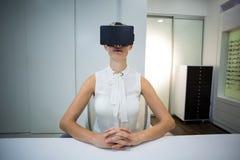 Woman using virtual reality headset Royalty Free Stock Photography