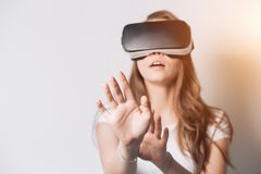 Woman using a virtual reality headset, Focus on the hand, fingers stock photo