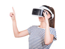 A woman is using a virtual reality headset, isolated on a white background. New audio equipment. A girl in virtual reality goggles Royalty Free Stock Photo
