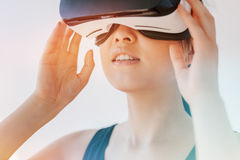 Woman using the virtual reality headset and looking away Royalty Free Stock Image