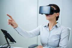 Woman using virtual reality headset. In optical store Stock Images