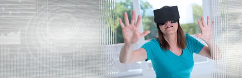 Woman using a virtual reality headset; panoramic banner. Mature woman using a virtual reality headset; panoramic banner royalty free stock photography
