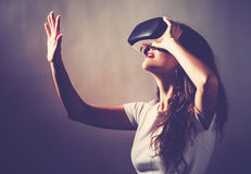 Woman using a virtual reality headset. Young woman using a virtual reality headset stock photos