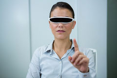 Woman using virtual video glasses. In optical store Royalty Free Stock Photography